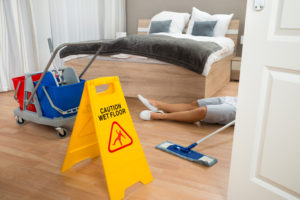 man laying on hotel floor after slipping from wet floor